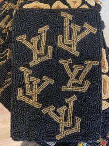 Gold LV Inspired crossbody beaded bag.