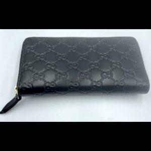 Gucci Black Zippy Wallet