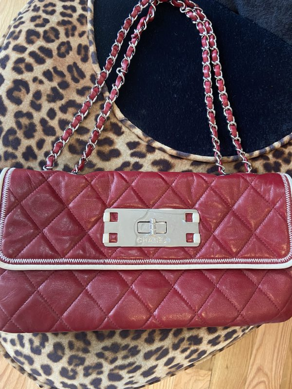 Maroon /Cream Trim Authentic Chanel Shoulder Bag. Beautiful quilted leather . Silver chain shoulder strap. Silver metal closure